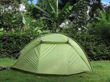 Camping on green slopes of Mount Meru
